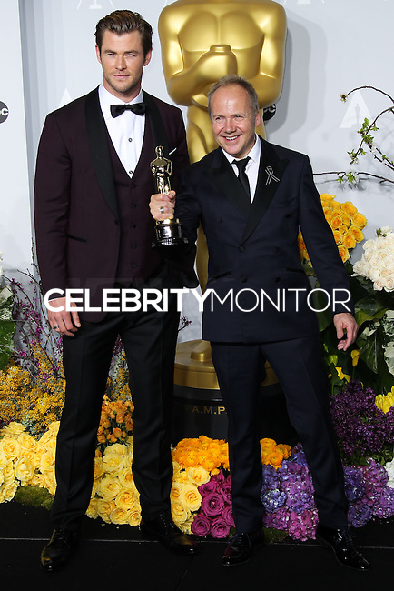 HOLLYWOOD, LOS ANGELES, CA, USA - MARCH 02: Chris Hemsworth, Glenn Freemantle at the 86th Annual Academy Awards - Press Room held at Dolby Theatre on March 2, 2014 in Hollywood, Los Angeles, California, United States. (Photo by Xavier Collin/Celebrity Monitor)