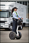 Nederland, Rotterdam, 21-09-2010 Ecomobiel een beurs voor  voor  professionals op het gebied van duurzame mobiliteit. Met auto's die rijden op waterstof,aardgas,bio gas,brandstofcellen,,waterstofcellen en vooral veel elektrische fietsen, scooters , personenauto's, bestelwagens .Op de foto Stadswacht op een Segway. FOTO: Gerard Til / Hollandse Hoogte