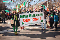 "Irish American Democratic club marches with their banner in the Sunnyside, Queens St. Patrick's Parade on March 5, 2017. Billed as ""St. Pat's For All"" the festive event started as an alternative to the New York parade, and organizers have endeavored to make the parade inclusive allowing gays and lesbians to march who were banned from the New York parade. (© Richard B. Levine)"