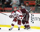 Colin Moore (Harvard - 12), Robbie Bourdon (Colgate - 17) - The Harvard University Crimson defeated the visiting Colgate University Raiders 6-2 (2 EN) on Friday, January 28, 2011, at Bright Hockey Center in Cambridge, Massachusetts.