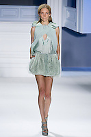Janice Alida walks runway in a mint textured silk V-neck drawstring top with super pique criss cross hooded cutaway overlay Mint organza and tulle drawstring bubble skirt, by Vera Wang for the Vera Wang Spring 2012 collection, during Mercedes-Benz Fashion Week Spring 2012.
