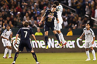 Omar Gonzalez (4) of the LA Galaxy battles with Stefani Miglioranzi (6) of the Philadelphia Union. The LA Galaxy defeated the Philadelphia Union 1-0 at Home Depot Center stadium in Carson, California on  April  2, 2011....