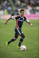 New England Revolution midfielder Diego Fagundez (14).  The New England Revolution played to a 1-1 draw against the Houston Dynamo during a Major League Soccer (MLS) match at Gillette Stadium in Foxborough, MA on September 28, 2013.