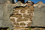Detail of brick and mortar construction covered by stucco at the mission district of  San Gabriel, California