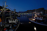 Fishing boats in the harbour at night time, Mogan, Gran Canaria, Canary Islands,