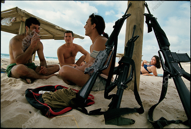 Off duty Israeli navy personnel at an Israeli settlement beach in Dogeet, Gaza. June 1994