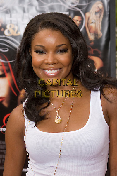 "GABRIELLE UNION.At the ""Hustle & Flow"" Los Angeles Film Premiere,.held at the Arclight Cinerama Dome, .Hollywood, California, USA, 20th July 2005..portrait headshot white vest tank top gold necklace.Ref: ADM.www.capitalpictures.com.sales@capitalpictures.com.©Zach Lipp/AdMedia/Capital Pictures."