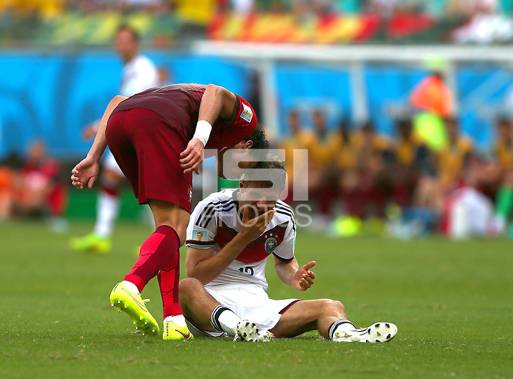 Pepe of Portgual head butts Thomas Muller of Germany and is shown a red card