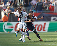 LA Galaxy midfielder Marcelo Sarvas (8) attempts to control the ball as New England Revolution midfielder Lee Nguyen (24) pressures. In a Major League Soccer (MLS) match, the New England Revolution (blue) defeated LA Galaxy (white), 5-0, at Gillette Stadium on June 2, 2013.