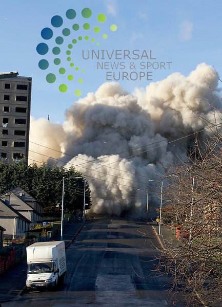 A tower block is brought down with controlled explosives, the multi-storey  block was built in 1967 and was levied in a seconds near Rosemount Street in Glasgow.<br /> Picture:Universal News And Sport (Europe) 1 December  2013