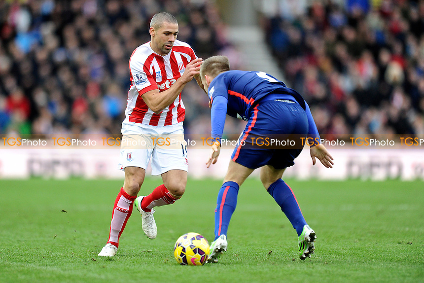 Jonathan Walters of Stoke City tries to get past Luke Shaw of Manchester United - Stoke City vs Manchester United - Barclays Premier League Football at the Britannia Stadium, Stoke-on-Trent - 01/01/15 - MANDATORY CREDIT: Greig Bertram/TGSPHOTO - Self billing applies where appropriate - contact@tgsphoto.co.uk - NO UNPAID USE
