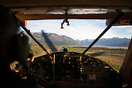 Helio Courier pilot lines up to land at Kluane Lake Research Station, Yukon