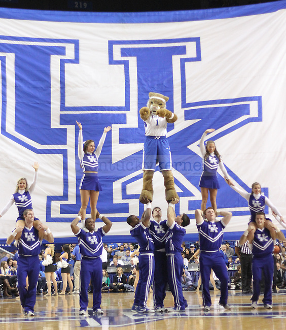 UK wildcat mascot helps perform a pyramid with the UK cheerleading team during a timeout in the second-half of the UK men's basketball game against Buffalo, in Rupp Arena on Sunday, November 16, 2014. Photo by Marcus Dorsey | Staff