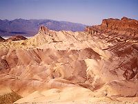 LAND SHAPING BY WIND AND WATER EROSION<br /> Zabriskie Point, Manley Beacon<br /> Death Valley National Monument, CA<br />  The fine grain mud &amp; siltstone prevent absorption of much water. The large runoff causes deep furrowing creating badlands that support almost no vegetation.