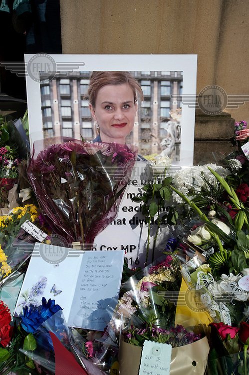 Flowers, notes and cards surround a photograph of murdered MP Jo Cox outside Batley Town Hall during an event to celebrate her 42nd birthday on 22 June 2016. Jo Cox was murdered nearby on the 16 June 2016 in her West Yorkshire constituency of Batley and Spen.