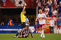 Referee Armando Villareal gives a yellow card to Joel Lindpere (20) of the New York Red Bulls for his foul on Alejandro Moreno (15). The New York Red Bulls and CD Chivas USA played to a 1-1 tie during a Major League Soccer (MLS) match at Red Bull Arena in Harrison, NJ, on May 23, 2012.