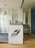 This child's room is furnished with a bunk bed with a seating area beneath and has an adjoining shower room