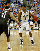 Tyler Thornton evaluates the court in the second half. Lehigh defeated Duke 75-70 during the 2nd round of the 2012 NCAA Basketball Championship at the Greensboro Coliseum in Greensboro, NC. Photo by Al Drago.