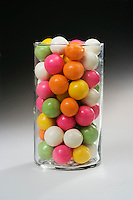 ESTIMATING A NUMBER: CANDIES IN CYLINDER<br /> (Variations Available)<br /> Colorful Malted Milk Balls<br /> Many candies in a clear cylindrical container to illustrate a problem in estimating the number.