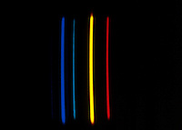 SPECTRUM ANALYSIS: EMISSION (BRIGHT LINE) SPECTRA<br /> Helium (He) Noble Gas<br /> Electrical discharge passes through the spectrum tube, which is filled with gas, causing electrons in the gas to be excited.  As the electrons relax, they emit light - a characteristic color for each gas.