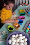 Girl coloring Easter eggs (multi-colors) for kid's Easter Egg hunt Issaquah Washington USA
