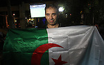 Algerian members of the 'Miles of Smiles' aid convoy, watch the Brazil FIFA World Cup 2014 round of 16 match between Algeria and Germany in Gaza City on June 30, 2014. Photo by Mohammed Asad