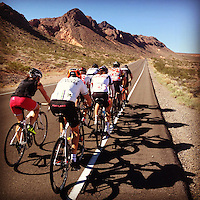 A group of cyclists rides near the Valley of Fire State Park and the Lake Mead National Recreation Area, outside of Las Vegas, Nevada.
