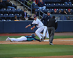 North Carolina-Wilmington's Thomas pope (7) dives back safely at third vs. Ole Miss third baseman Andrew Mistone (25) at Oxford-University Stadium in Oxford, Miss. on Saturday, February 25, 2012. Ole Miss won 6-4.