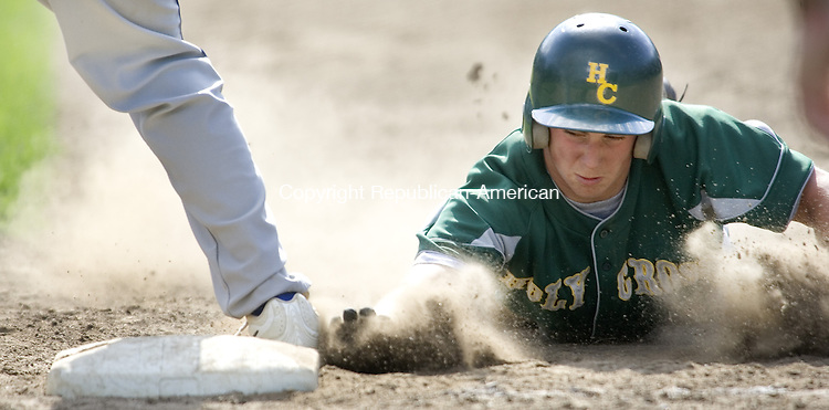BRISTOL, CT. 01 June 2008-060108SV11--#5 Chris Pagliaro of Holy Cross gets back to first against East Catholic during CIAC Class M quarterfinal action at Muzzy Field in Bristol Sunday. Holy Cross won 3-1.<br /> Steven Valenti Republican-American