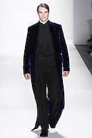 Model walks runway A MEN&rsquo;S SAPPHIRE SILK VELVET IMPERIAL ROBE LINED W/&quot;ONE THOUSAND NIGHTS &amp; ONE NIGHT LINING, MENS EBONY ITALIAN SILK DUPIONI TUXEDO SHIRT + BOW TIE, AND MEN&rsquo;S EBONY ITALIAN SILK DUPIONI EVENING TROUSERS by Zang Toi, for the Zang Toi Spring 2012 My Dream Of North Africa Collection, during Mercedes-Benz Fashion Week Spring 2012.