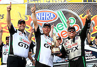 Oct 6, 2013; Mohnton, PA, USA; NHRA funny car driver John Force (right) celebrates with crew chief Jimmy Prock (center) after winning the Auto Plus Nationals at Maple Grove Raceway. Mandatory Credit: Mark J. Rebilas-