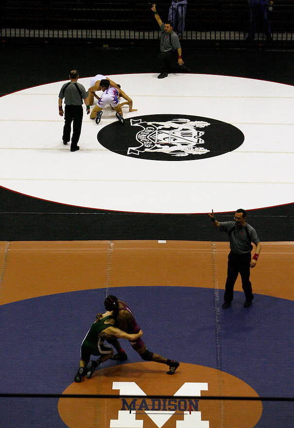 Wrestlers compete during the boys' finals of the Region IV wrestling tournament at Littleton Gymnasium on Saturday, Feb. 11, 2012. Austin Bowie won the tournament with 151 points.