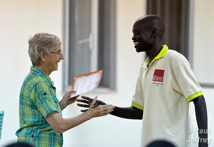 Sister Dorothy Dickson, a member of Sisters of Our Lady of the Missions, congratulates a student during a ceremony at the Catholic Health Training Institute in Wau, South Sudan, which trains nurses and midwives in the newly independent country. Dickson, from New Zealand, is director of the institute. The Institute is coordinated by Solidarity with South Sudan, an international consortium of more than 200 religious congregations that trains teachers, health workers and pastoral personnel in several locations throughout South Sudan.