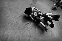 """A female Lucha libre wrestler locks her sparring partner in a hold during the training lesson at a combat sports gym in Mexico City, Mexico, 28 April 2011. Lucha libre, literally """"free fight"""" in Spanish, is a unique Mexican sporting event and cultural phenomenon. Based on aerial acrobatics, rapid holds and the use of mysterious masks, Lucha libre features the wrestlers as fictional characters (Good vs. Evil). Women wrestlers, known as luchadoras, often wear bright shiny leotards, black pantyhose or other provocative costumes. Given the popularity of Lucha libre in Mexico, many wrestlers have reached the cult status, showing up in movies or TV shows. However, almost all female fighters are amateur part-time wrestlers or housewives. Passing through the dirty remote areas in the peripheries, listening to the obscene screams from the mainly male audience, these no-name luchadoras fight straight on the street and charge about 10 US dollars for a show. Still, most of the young luchadoras train hard and wrestle virtually anywhere dreaming to escape from the poverty and to become a star worshipped by the modern Mexican society."""