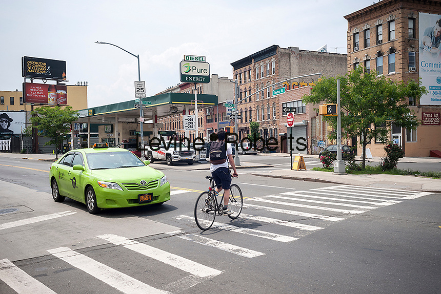 Flushing Avenue intersection in the Bushwick neighborhood in Brooklyn in New York on Saturday, June 4, 2016. The neighborhood has undergone gentrification changing from a rough and tumble mix of Hispanic and industrial to a haven for hipsters, forcing many of the long-time residents out because of rising rents.. (© Richard B. Levine)