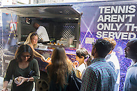 "Tennis fans and foodies flock to Madison Square in New York on Monday, August 11, 2014 for samples from the menu of foods being sold at the US Open. The US Tennis Association (USTA) is promoting eating at the Open, which has a reputation for serving notoriously over-priced food, with a food truck visiting the city serving gourmet items from celebrity chefs and from the Open's ""Food Village"" Samples include Lobster Roll and David Burke Filet Slider. The US Open runs from Aug. 25 through Sept. 8 in Arthur Ashe Stadium in Queens.  (© Richard B. Levine)"