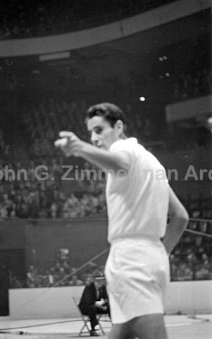 American tennis player Pancho Gonzales in action vs Australian Ken Rosewall, Madison Square Garden, 1957. Photograph by John G. Zimmerman.