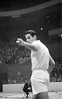 American tennis player Pancho Gonzales in action vs Australian Ken Rosewall, Madison Square Garden, 1957. Photograph by John G. Zimmerman.