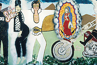 An unknown artist painted this mural on a backstreet in Albuquerque,New Mexico depicting a pop culture celebration including the Latina singer Selena, Elvis Presley, the Virgin of Guadalue and a Harley Davidson motorcycle.