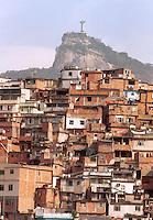 Rio de Janeiro favela - Morro da Coroa ( Coroa slum ) at Santa Teresa quarter, Brazil - Christ the Redeemer and Corcovado mountain in the background.