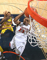 CHARLOTTESVILLE, VA- NOVEMBER 29: Mike Scott #23 of the Virginia Cavaliers grabs the rebound during the game on November 29, 2011 at the John Paul Jones Arena in Charlottesville, Virginia. Virginia defeated Michigan 70-58. (Photo by Andrew Shurtleff/Getty Images) *** Local Caption *** Mike Scott