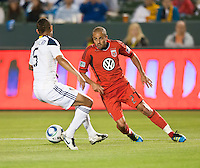 CARSON, CA – June 3, 2011: DC United midfielder Fred (27) makes a move to get past LA Galaxy defender Sean Franklin during the match between LA Galaxy and DC United at the Home Depot Center in Carson, California. Final score LA Galaxy 0, DC United 0.