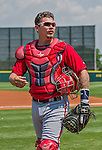 20 March 2015: Washington Nationals catcher Jose Lobaton returns to the dugout after warming up prior to a Spring Training game against the Houston Astros at Osceola County Stadium in Kissimmee, Florida. The Nationals defeated the Astros 7-5 in Grapefruit League play. Mandatory Credit: Ed Wolfstein Photo *** RAW (NEF) Image File Available ***
