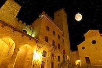 Medieval houses at night around Plazza Duomo - San Gimignano - Italy