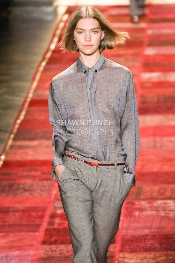 Arizona Muse walks runway in an outfit from the Tommy Hilfiger Fall 2011 Bohemian Prep collection, during Mercedes-Benz Fashion Week Fall 2011.