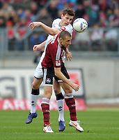 FUSSBALL   1. BUNDESLIGA  SAISON 2011/2012   24. Spieltag 1. FC Nuernberg - Borussia Moenchengladbach      04.03.2012 Havard Nordtveit (li, Borussia Moenchengladbach) GEGEN Timmy Simons (1 FC Nuernberg)