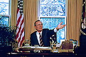 United States President George H.W. Bush asks a question during a briefing on the upcoming Malta Summit with Soviet President Mikhail Gorbachev (not pictured) in the Oval Office of the White House in Washington, D.C. on November 28, 1889..Credit: Arnie Sachs / CNP
