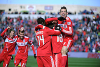 Chicago Fire midfielder Marco Pappa (16, far right) and his teammates celebrate Gaston Puerari's (18, 2nd from right) goal.  The Chicago Fire defeated Sporting KC 3-2 at Toyota Park in Bridgeview, IL on March 27, 2011.