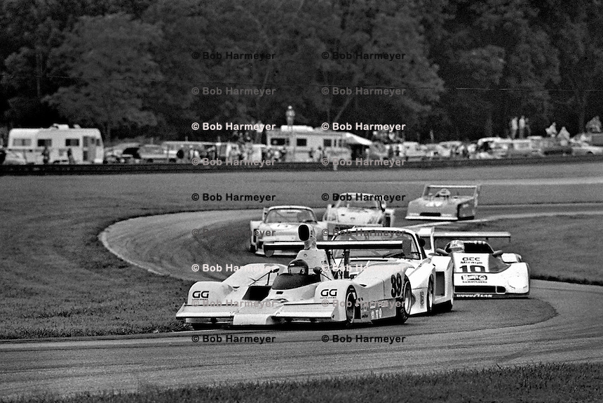 """LEXINGTON, OH - AUGUST 26: The Lola/Gp8 driven by John Gunn and Gary Belcher leads a group of cars into the """"Keyhole"""" corner during the  Lumbermens 500 North American Sports Car Championship at the Mid-Ohio Sports Car Course near Lexington, Ohio, on August 26, 1979."""