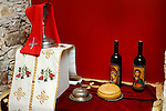 Cyprus sacramental wine with religious icons on bottle labels and a loaf of bread